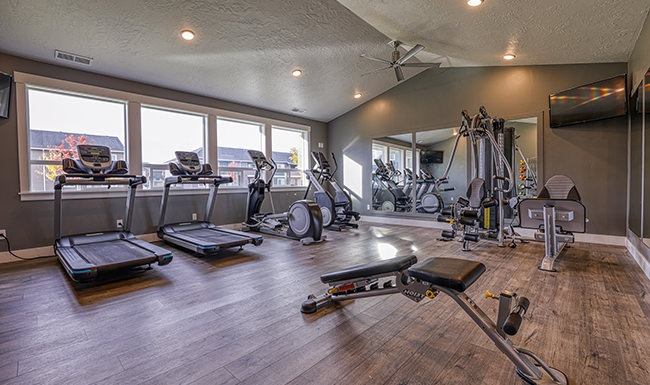 open fitness center with ample equipment